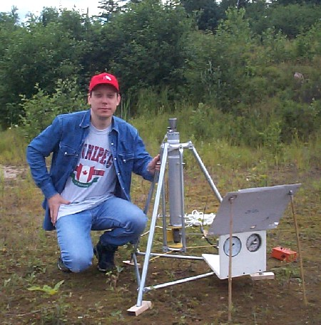 Author with rocket in test stand